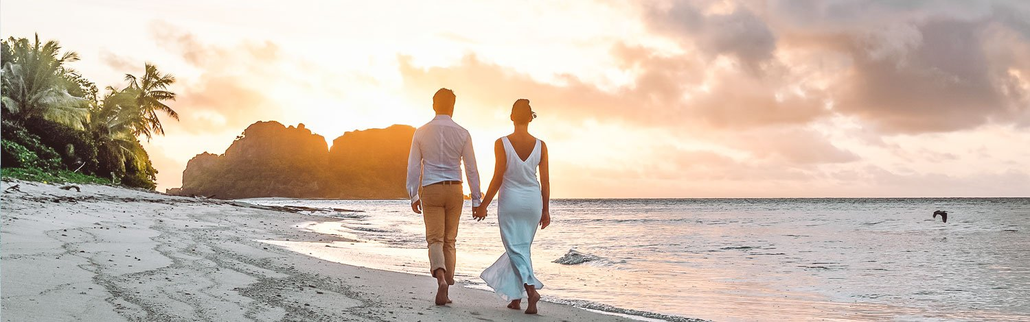 Couple Walking Along Beach Toward Vomo Lailai Romantic Holidays Vomo Island Fiji