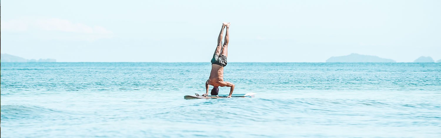 Paddleboarding On Vomo Island Fiji Man Upside Down On Paddle Board